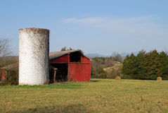 Old White Silo and an Old Red Barn Royalty Free Stock Photography