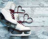 Old white skates for figure skating with a hearts of laces Royalty Free Stock Photography