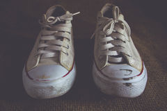 Old white sneakers Stock Photography