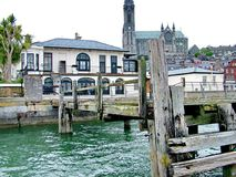 Old White Star Line Offices and pier in Cobh, Co. Cork, Ireland. The original pier where passengers board the tenders PS Ireland and PS America to join the RMS stock image