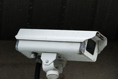 Old white surveillance camera Royalty Free Stock Images