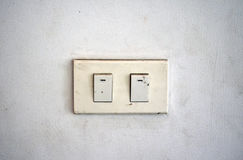 Old white switch on the wall Royalty Free Stock Photos