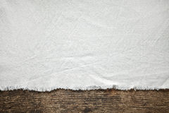 Old white tablecloth on wooden table Royalty Free Stock Photos