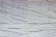 Old white tarpaulins fabric texture. Old white tarpaulins surface, tarpaulins texture material is from plastic, wavy and wrinkle tarpaulins Royalty Free Stock Images