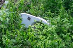 An old white toilet bowl Stock Image