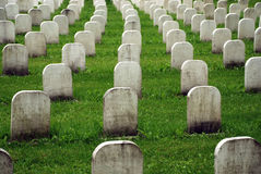 Old white tombstones in a cemetery. stock photo