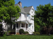 Old White Victorian Home - The American Dream. The quintessential American home - old, white Victorian with grassy front yard Royalty Free Stock Photos