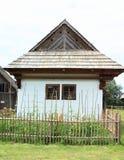 Old white village house with garden in open-air museum. Old white village house with shingles roof with wooden fence and garden in open-air museum Liptov Village Stock Photos