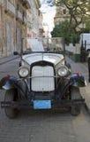 Old white vintage car 2. Havana, Cuba - January 2, 2011; Old white vintage car in street in Havana Cuba Stock Photography
