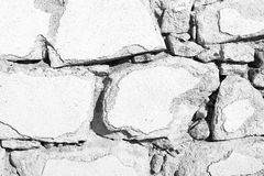 Old white  vintage stone wall background. Old white grunge vintage stone wall background Royalty Free Stock Images