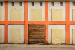 Old White Wall With Checkered Pattern Detail and wooden doorway Stock Photos