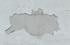 Old white wall with fallen off plaster royalty free stock images