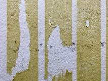Scratched wall. An old white wall in the room which has some scratches and stickers looks dirty Royalty Free Stock Image