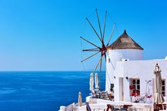 Old white windmill near sea Royalty Free Stock Images