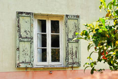 Old white window with light green shutters Stock Image