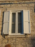 Old white window with shutters Royalty Free Stock Photography