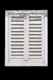 Old white window with wooden shutters. Old white window with wooden shutters isolated on a black background Stock Images