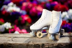 Old white women`s roller skate stock photo