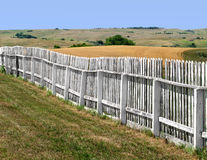 Old white wood fence in a field Stock Photography