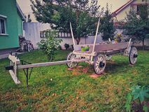 Old white wooden carriage. On a green grass Royalty Free Stock Images