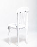 Old white wooden chair against white background at studio Stock Image