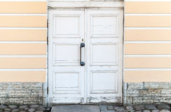 Old white wooden door in classical building facade Stock Photography
