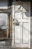 Old white wooden door with post box Stock Images