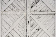 Old White Wooden Doors. Leading to an abandoned barn Royalty Free Stock Image