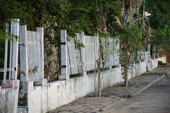 Old white wooden fence was broken Stock Images