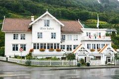 Old white wooden hotel in Utne, Norway Stock Photo
