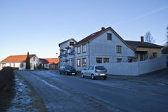 Old white wooden houses in Halden. In Halden, there are many old houses, most of the houses are from after 1826 when a major fire put almost the entire city Royalty Free Stock Photo