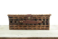 Old wicker bag on wooden Royalty Free Stock Photography