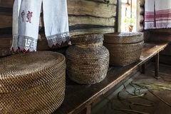 Old wicker basket on the bench in the a village house for print stock images