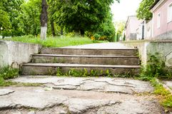Old wide concrete steps. Against the backdrop of green trees. Summer day stock photography