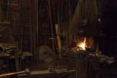 Old Wild West Blacksmith Shop. Fire forge buring in old wild west blacksmith shop royalty free stock images