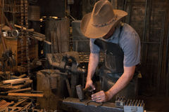 Old Wild West Blacksmith Hammering Stock Photos