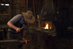 Old Wild West Blacksmith Hammering Royalty Free Stock Images
