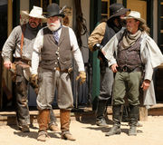 Old Wild West Gunfighters. Old West cowboy gunfighter actors on the old dusty town street during realistic reenactment at Old West History Festival in Arizona Stock Image