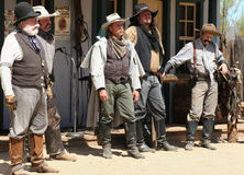 Old Wild West Gunfighters. Old West cowboy gunfighter actors on the old dusty town street during realistic reenactment at Old West History Festival in Arizona Stock Photography