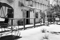 Old wild west town cantina. Old wild western town Mexican cantina on desert sand main street with buggy parked outside Stock Photos