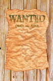 Old Wild West Wanted Poster. An Old Wild West Wanted Poster on backdrop of wooden planks that can easily be used in any design - enjoy Stock Images