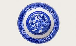 Blue and white decorated chinese bowl on white background stock photo