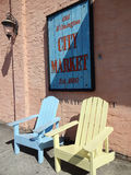 Old Wilmington City Market Sign and Adirondack Chairs. Outside shops in Historic Wilmington. Established in 1880. Part of New Hanover County. Across from the royalty free stock images