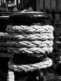 Old winch with ship rope Stock Images