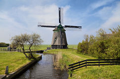 Old wind mill in Holland. Netherlands Royalty Free Stock Image