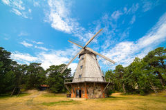 Old wind mill at the park with blue sky and clouds Royalty Free Stock Photo