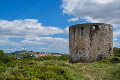 Old wind mill on Torres Vedras Portugal. Torres Vedras Portugal. 18 May 2017.Old abandoned wind mill on Torres Vedras.Torres Vedras, Portugal. photography by royalty free stock image