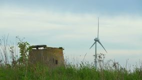 Old wind mill and wind turbine stock footage
