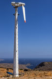 Old wind turbine in Kythnos island, Cyclades, Greece Stock Photos