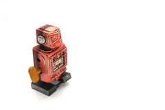 Old wind up robot. Red wind up robot without arms is more than 30 years old Royalty Free Stock Images
